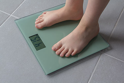 Too much weight harms kids feet.